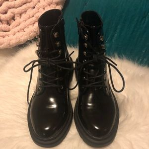 Shiny black combat boots